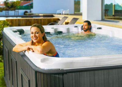 Couple having fun in swim spa